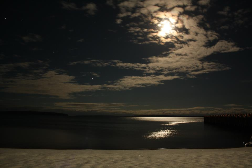 November 26, 2012 photo of Jupiter near the moon over Lake Superior in northern Wisconsin by Migizi Gichigumi